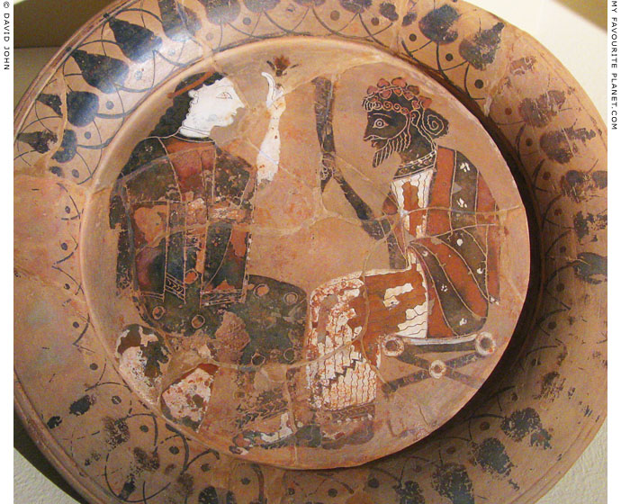 Attic plate depicting Dionysus and woman sitting together at My Favourite Planet