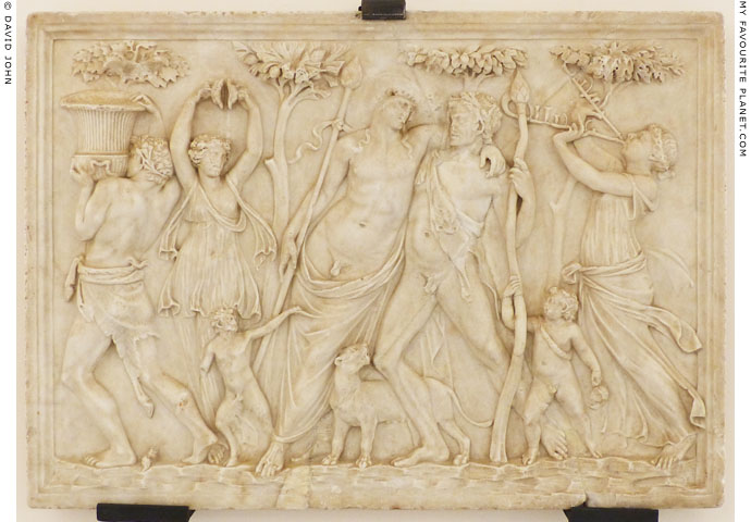 A marble relief with drunken Dionysus supported by a satyr between two maenads at My Favourite Planet