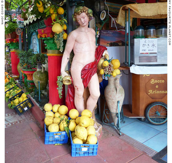 A modern plaster figure of Bacchus in Pompeii at My Favourite Planet