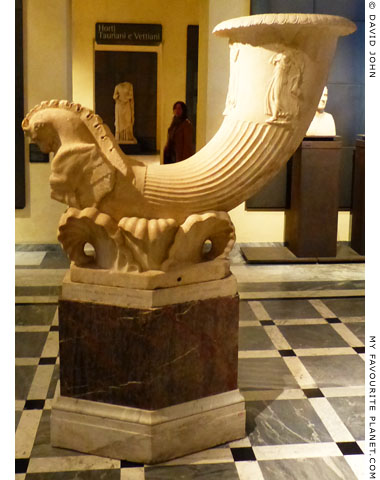 A marble fountain in the shape of a horn with a relief of dancing maenads at My Favourite Planet