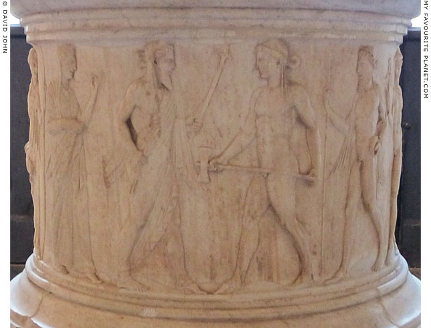 Hephaistos on a Roman puteal relief at My Favourite Planet