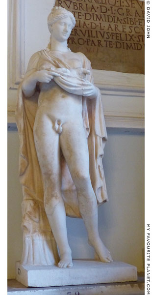 A marble statuette of Hermaphroditus carrying an infant Eros in the fold of her garment at My Favourite Planet