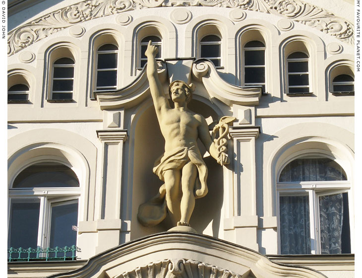 A statue of Hermes on a house facade Berlin at My Favourite Planet