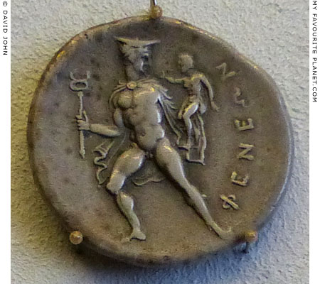 A silver stater of Pheneos showing Hermes carrying the infant Arkas at My Favourite Planet