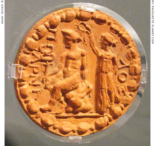 Clay disc depicting Nike crowning Hermes at My Favourite Planet
