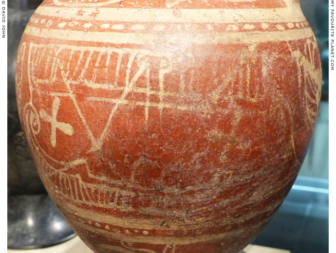 Painting of a man sitting in a ship on an Etruscan amphora at My Favourite Planet