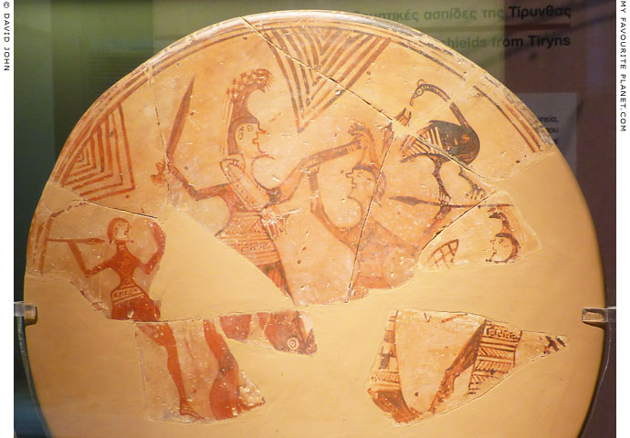 A warrior killing an Amazon on a terracotta votive shield from Tiryns at My Favourite Planet