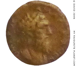 Bronze coin showing the head of Homer at My Favourite Planet