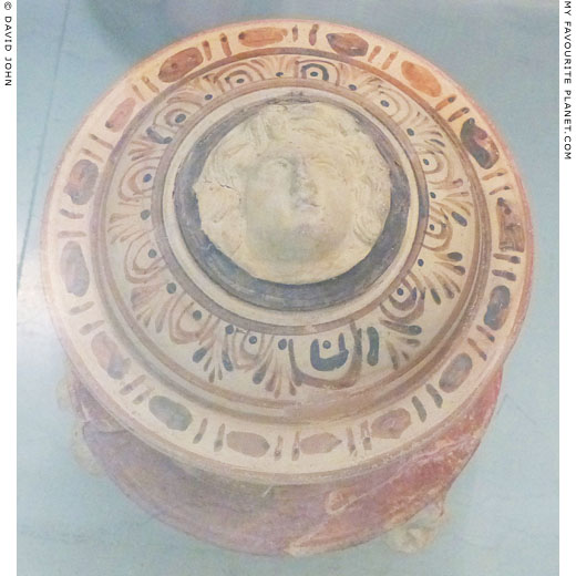 Gorgoneion relief on the lid of a pyxis from Amphipolis at My Favourite Planet