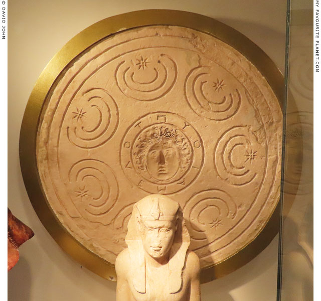 A Gorgoneion on a limestone model for a shield at My Favourite Planet