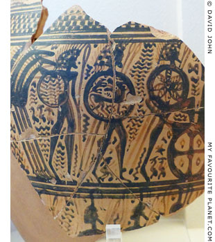 Warriors with round shields decorated with devices on an vase from Athens at My Favourite Planet