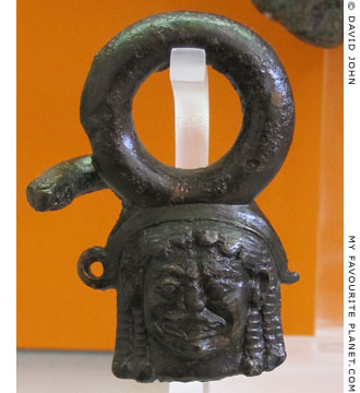 Bronze handle of a ritual vessel with a head of the Gorgon Medusa at My Favourite Planet