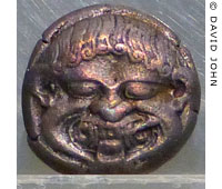 Coin of ancient Neapolis with a Gorgon's head at My Favourite Planet
