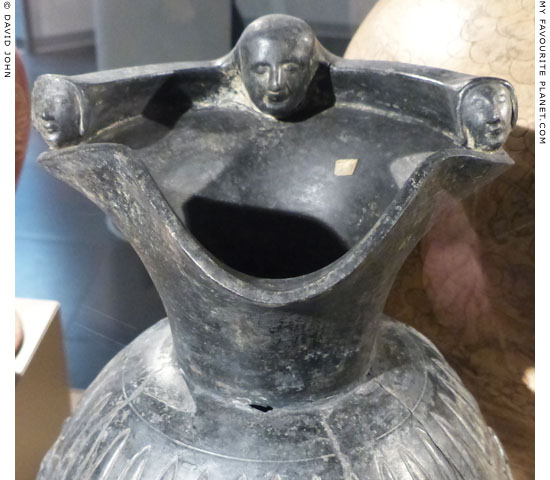 Protomes on the trefoil mouth of the Etruscan bucchero oinochoe in Milan at My Favourite Planet