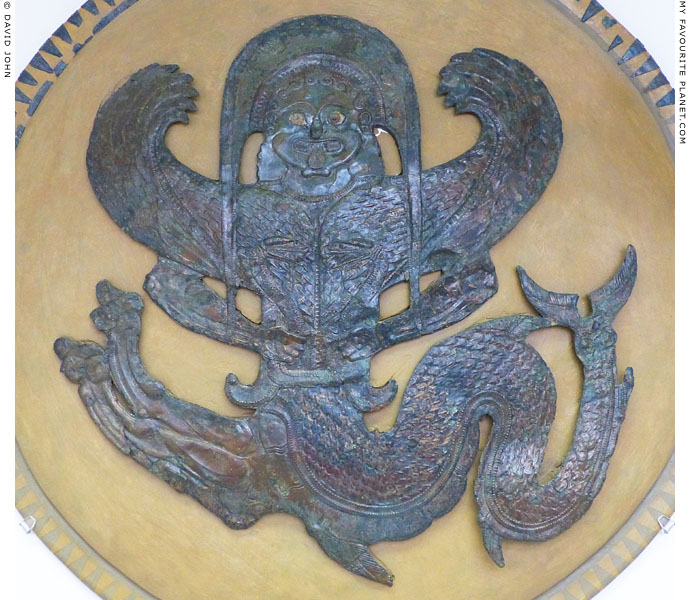 A winged Gorgon on a bronze shield device, Olympia Archaeological Museum at My Favourite Planet