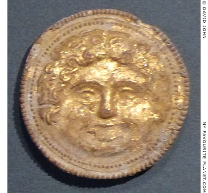 A gilded terracotta disc with a Gorgon head from Thermi, Macedonia Greece at My Favourite Planet