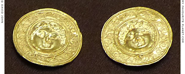 Gold buttons with Gorgon heads from a tomb in Mieza, Macedonia at My Favourite Planet