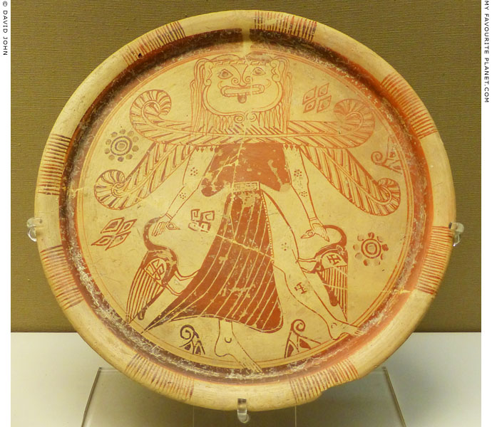 A plate showing a winged goddess with a Gorgon head at My Favourite Planet