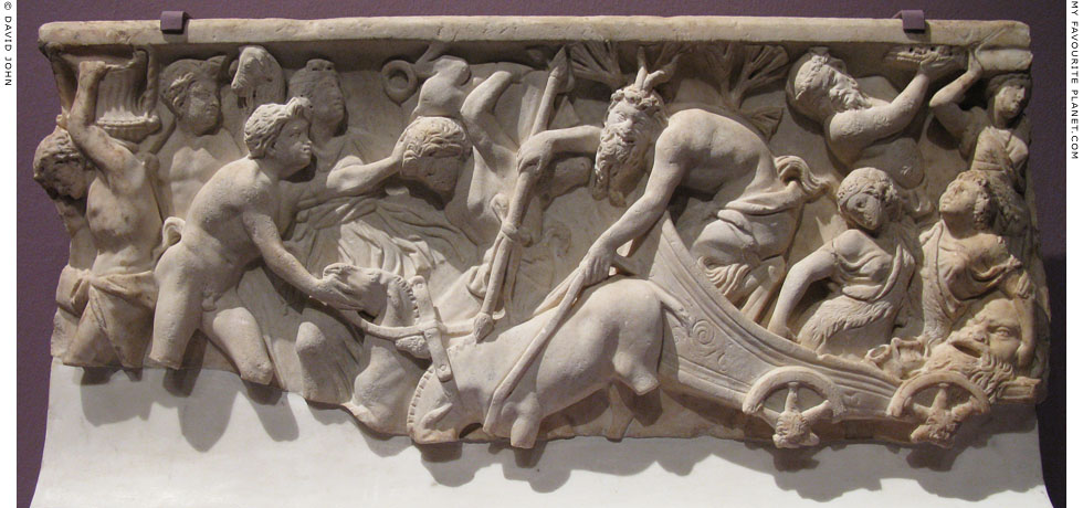 A relief depicting Pan driving a wagon in a Dionysian procession at My Favourite Planet